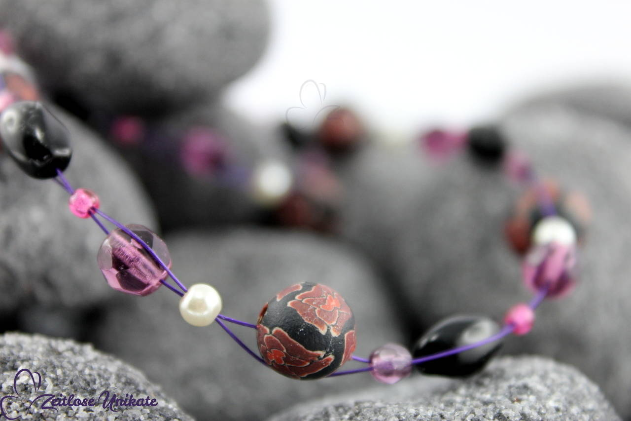 Halskette lila schwarz