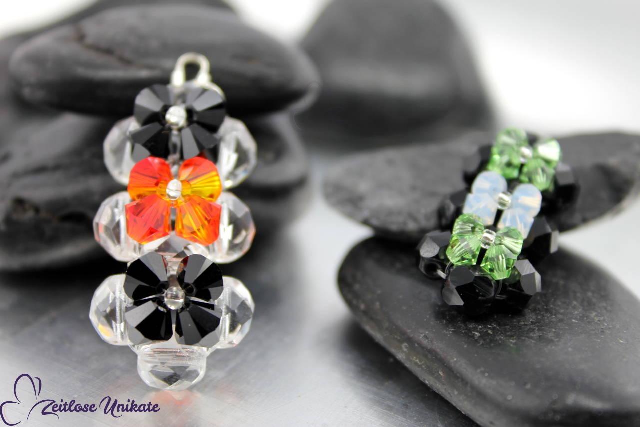 Anhänger aus Swarovski® Perlen rotorange schwarz transparent