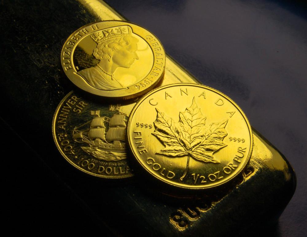 Gold Münzen und Barren