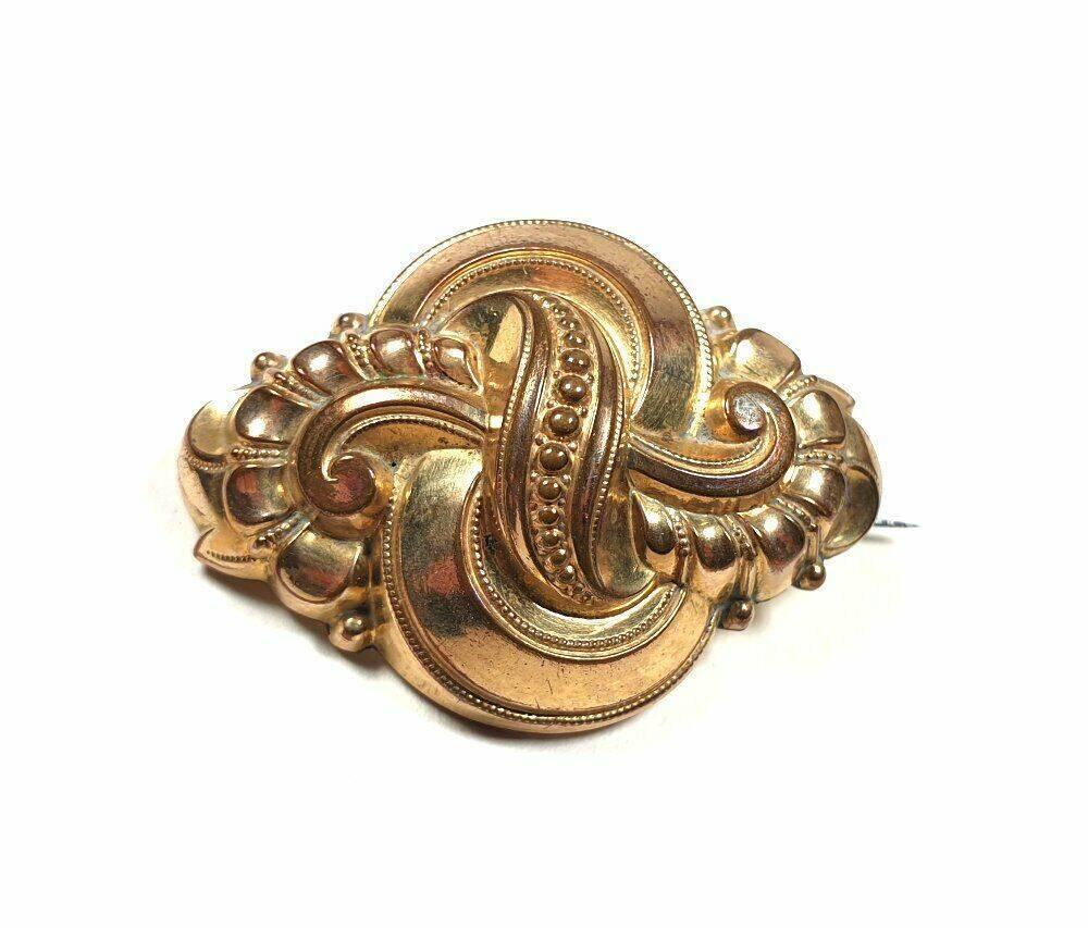 alte Schaumgold Brosche in Knoten Form