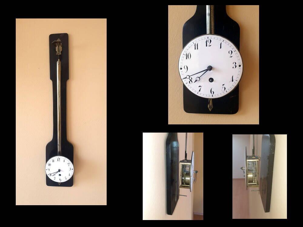 sehr seltener Freischwinger, Pendule, Wanduhr Uhrwerk und Zifferblatt schwingen mit dem Pendel mit